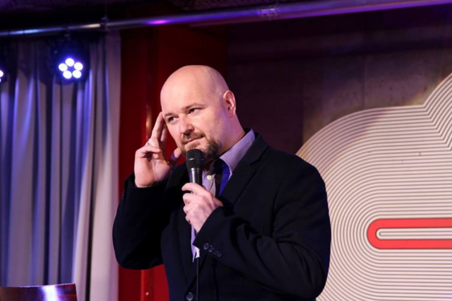 Christian A. Dumais performing comedy in Poland.