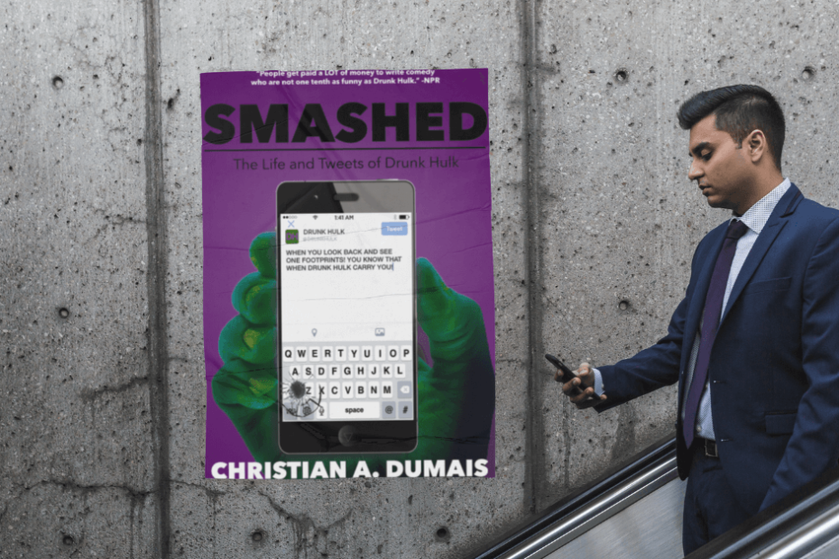 A man on an escalator using his phone with a poster of Smashed: The Life and Tweets of Drunk Hulk in the background.